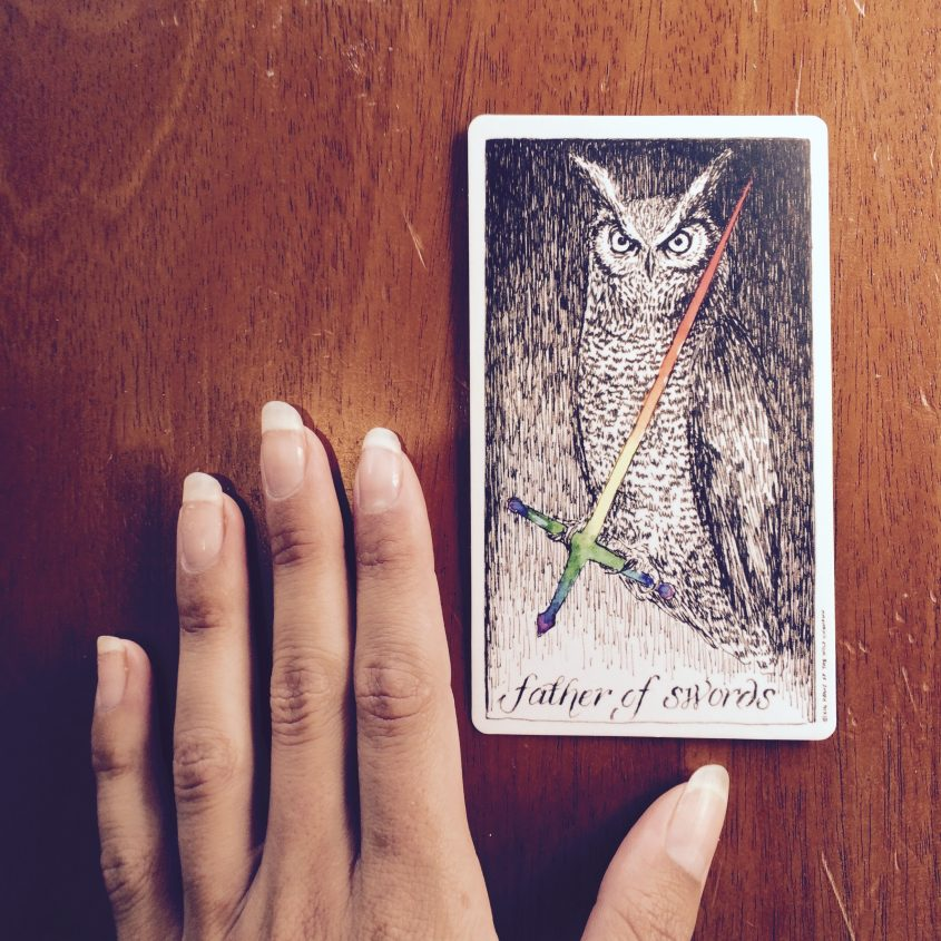the wild unknown tarot father of swords meaning and interpretation